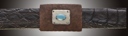 One inch rectangular buckle with pounded copper, silver inset and turquoise stone.